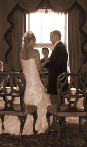 castle-hill-wedding-exchanging-rings.jpg